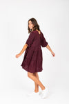 The Davian Tiered Dress in Deep Plum, studio shoot; side view