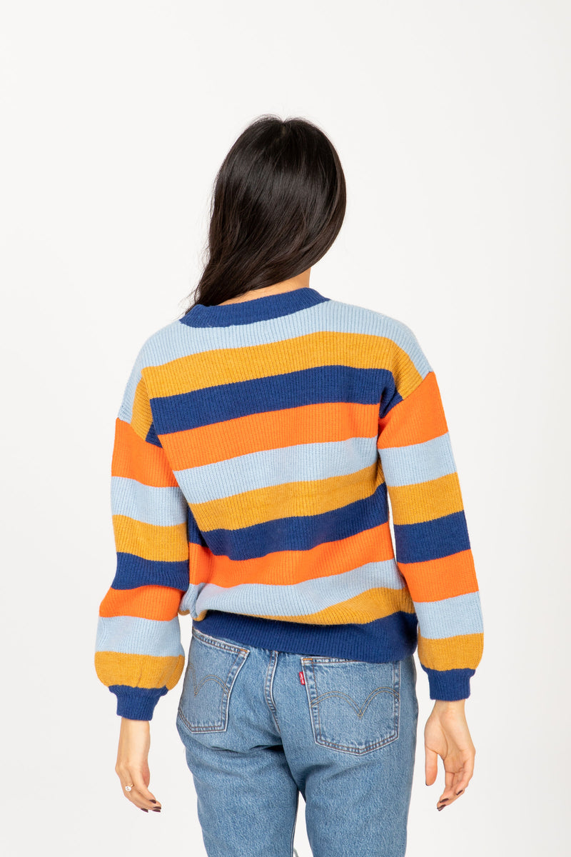 The Cut Striped Sweater in Navy + Rust Multi, studio shoot; back view