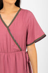 Piper & Scoot: The Presley Detail Wrap Dress in Deep Mauve, studio shoot; closer up front view view
