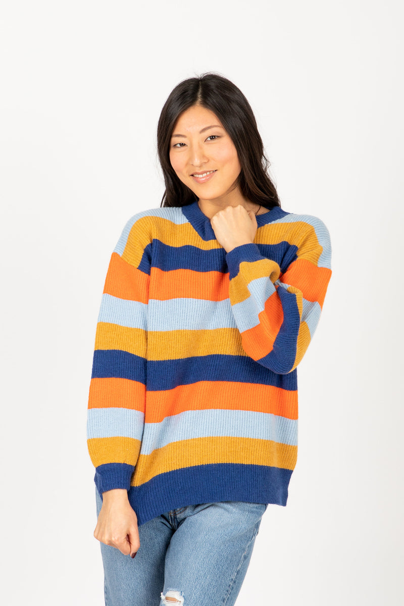 The Cut Striped Sweater in Navy + Rust Multi, studio shoot; front view