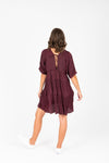 The Davian Tiered Dress in Deep Plum, studio shoot; back view