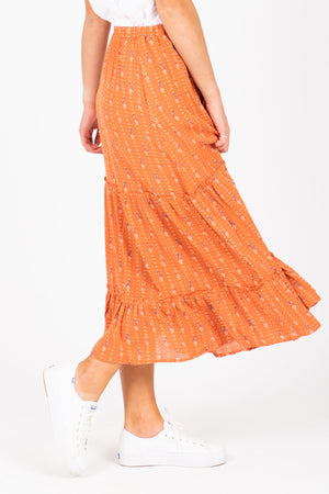 The Danna Floral Tiered Skirt in Rust, studio shoot; side view