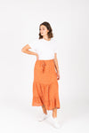 The Danna Floral Tiered Skirt in Rust, studio shoot; front view