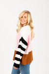 The Rise Striped Contrast Sweater in Blush Multi, studio shoot; side view