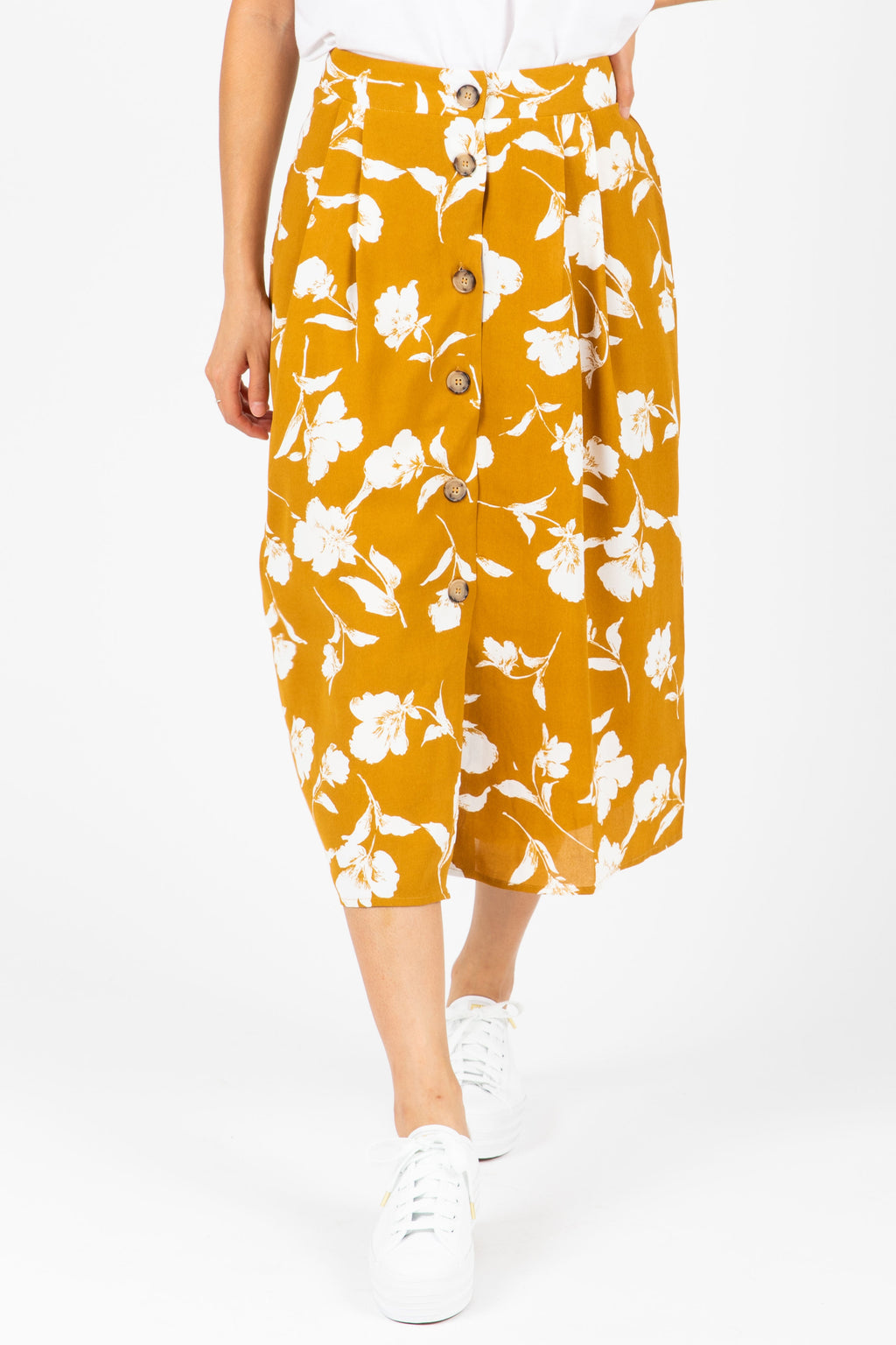 The Hale Floral Button Skirt in Mustard, studio shoot; front view