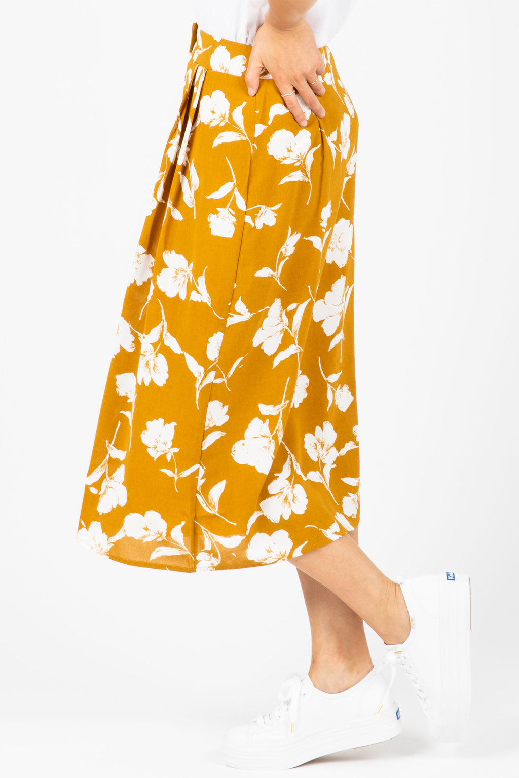 The Hale Floral Button Skirt in Mustard, studio shoot; side view