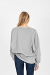 The Van Button Sweatshirt in Heather Grey, studio shoot; back view