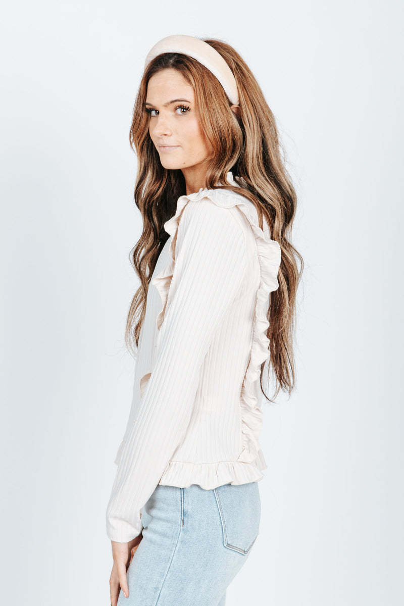 The Ariel Ruffle Detail Blouse in Cream, studio shoot; side view
