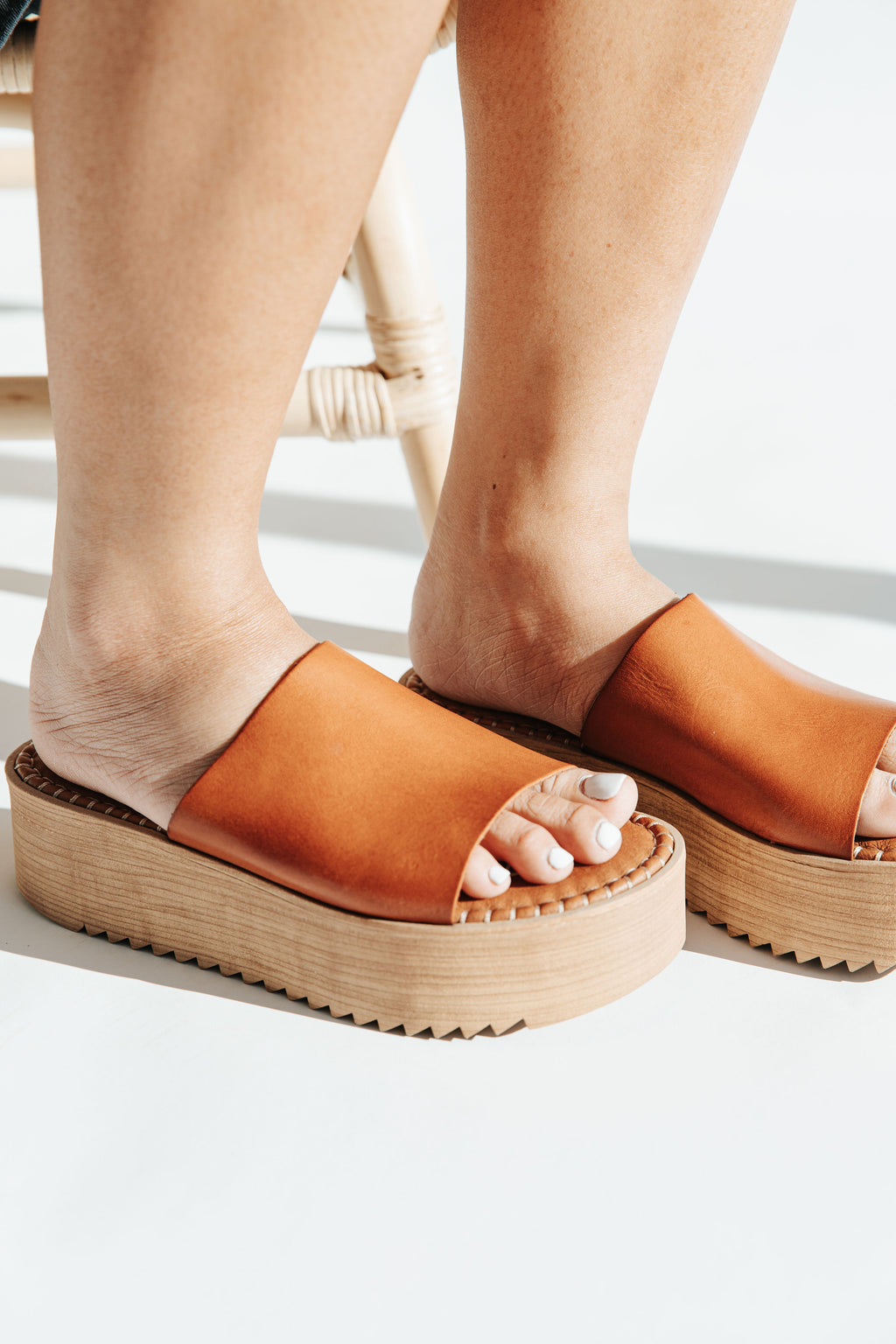 The Kristel Platform Sandal in Camel, studio shoot; side view