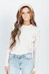 The Ariel Ruffle Detail Blouse in Cream, studio shoot; front view