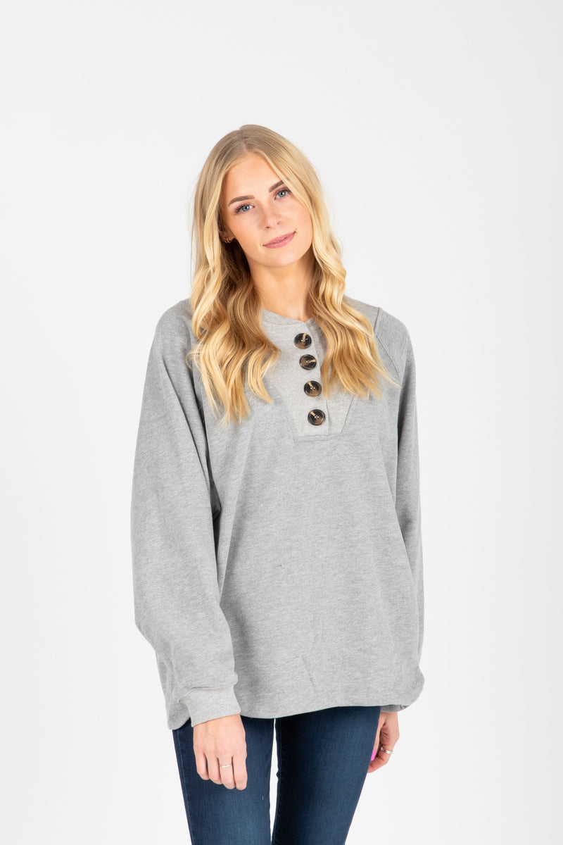 The Van Button Sweatshirt in Heather Grey, studio shoot; front view