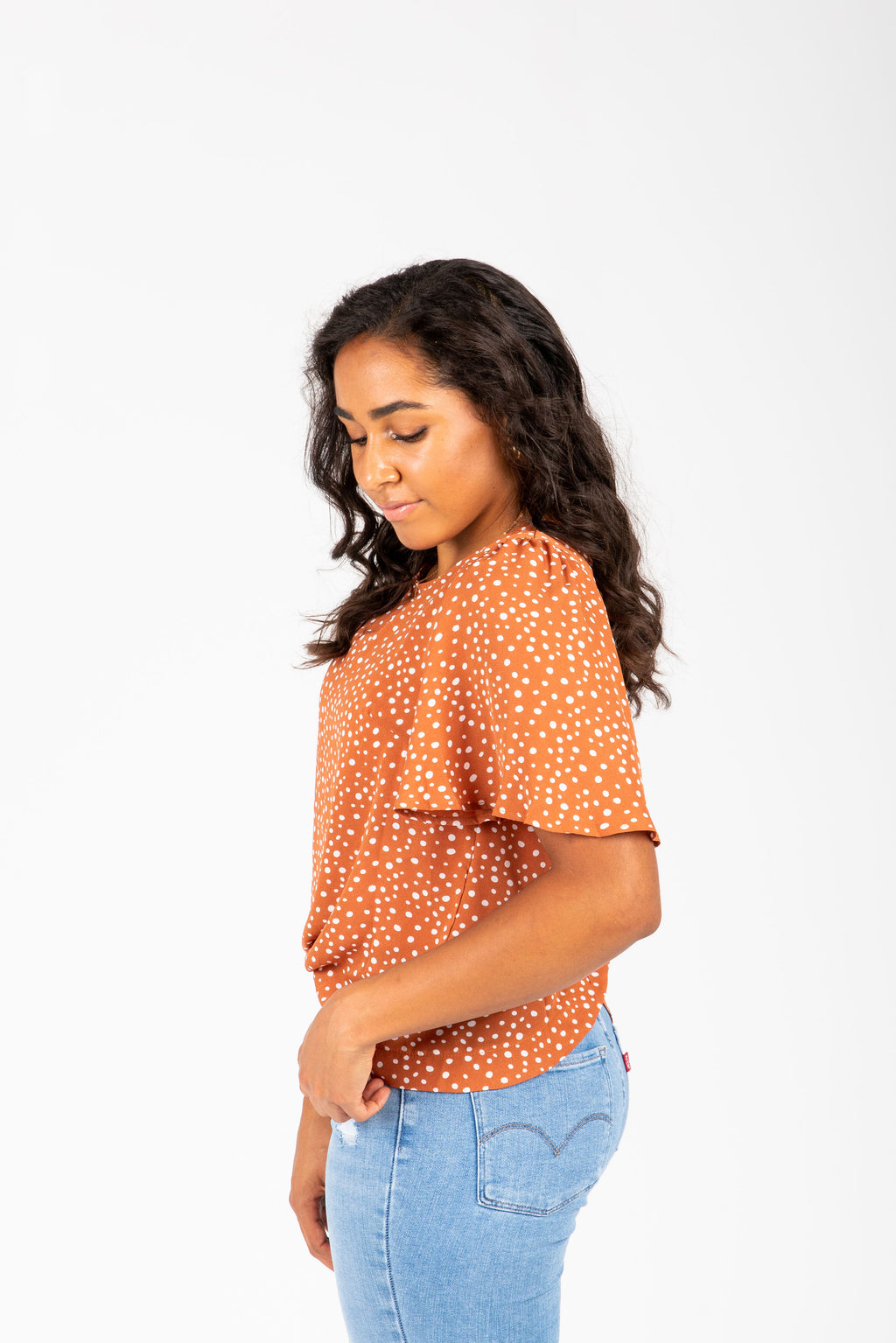 The Kieran Dot Button Blouse in Clementine, studio shoot; side view