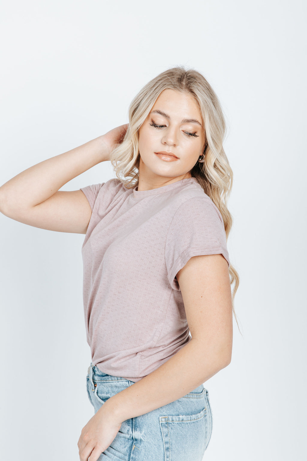 The Norman Tee in Dusty Lavender, studio shoot; side view