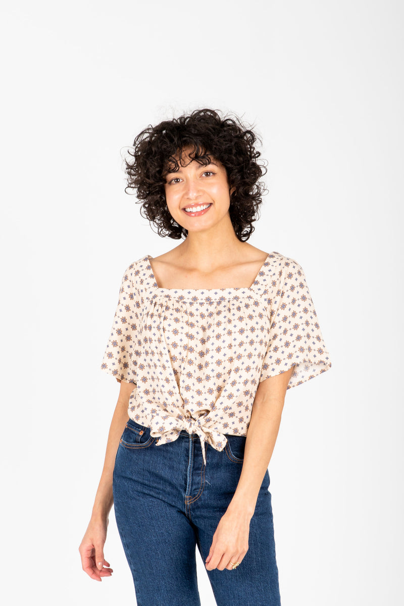 The Brock Patterned Tie Front Blouse in Natural, studio shoot; front view