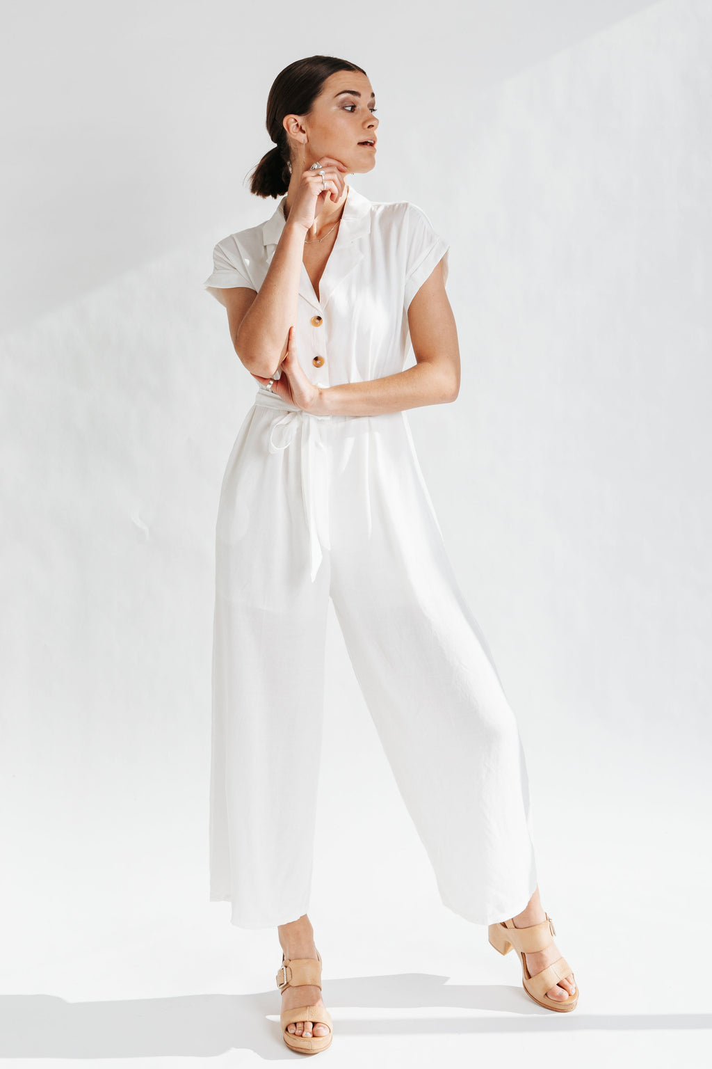 The Monrovia Button Down Jumpsuit in Ivory, studio shoot; front view