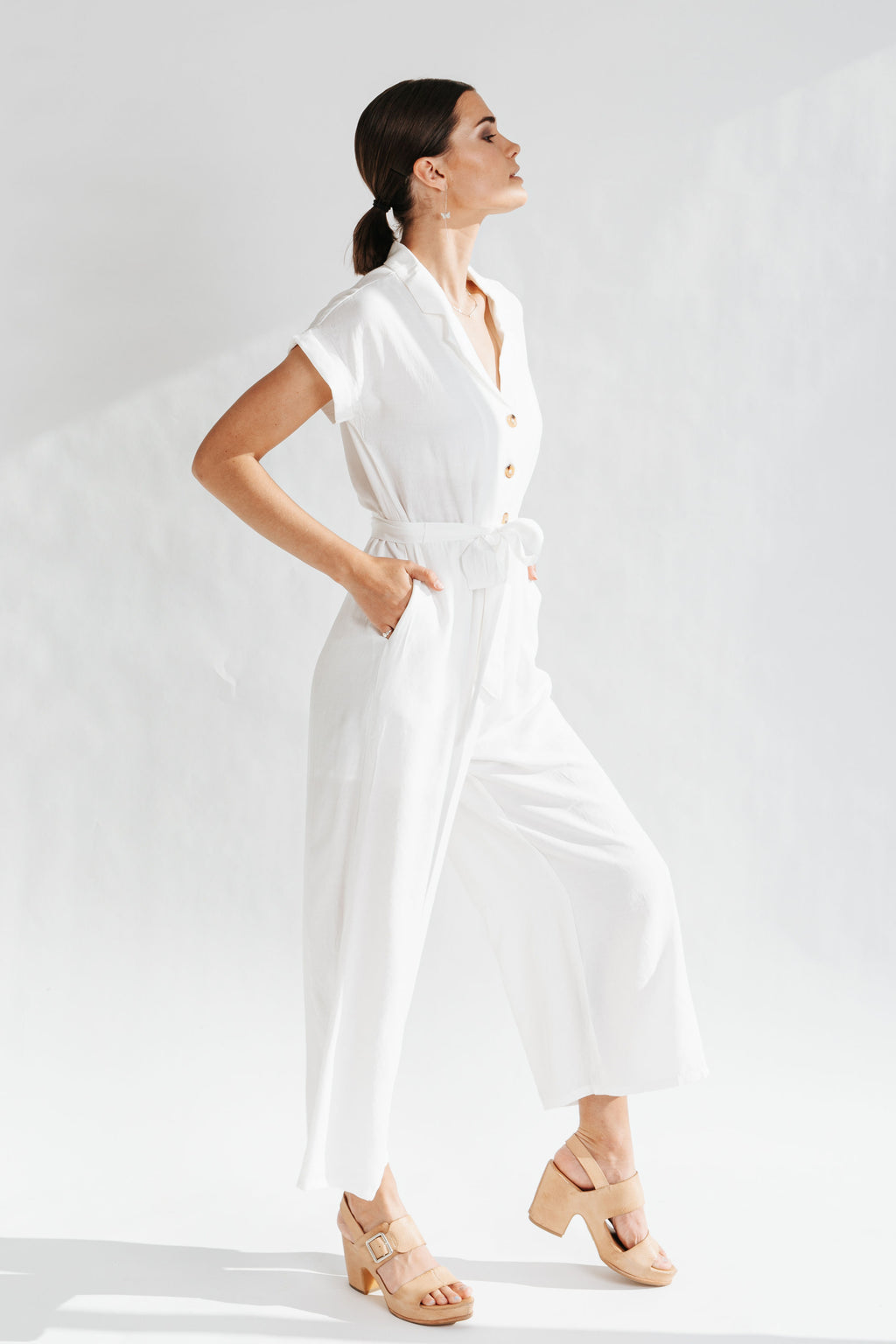 The Monrovia Button Down Jumpsuit in Ivory, studio shoot; side view