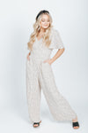 The Seth Polka Dot Jumpsuit in Cream, studio shoot; front view