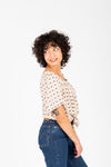 The Brock Patterned Tie Front Blouse in Natural, studio shoot; side view