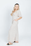 The Seth Polka Dot Jumpsuit in Cream, studio shoot; side view