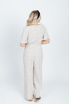 The Seth Polka Dot Jumpsuit in Cream, studio shoot; back view