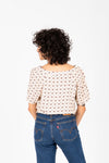 The Brock Patterned Tie Front Blouse in Natural, studio shoot; back view