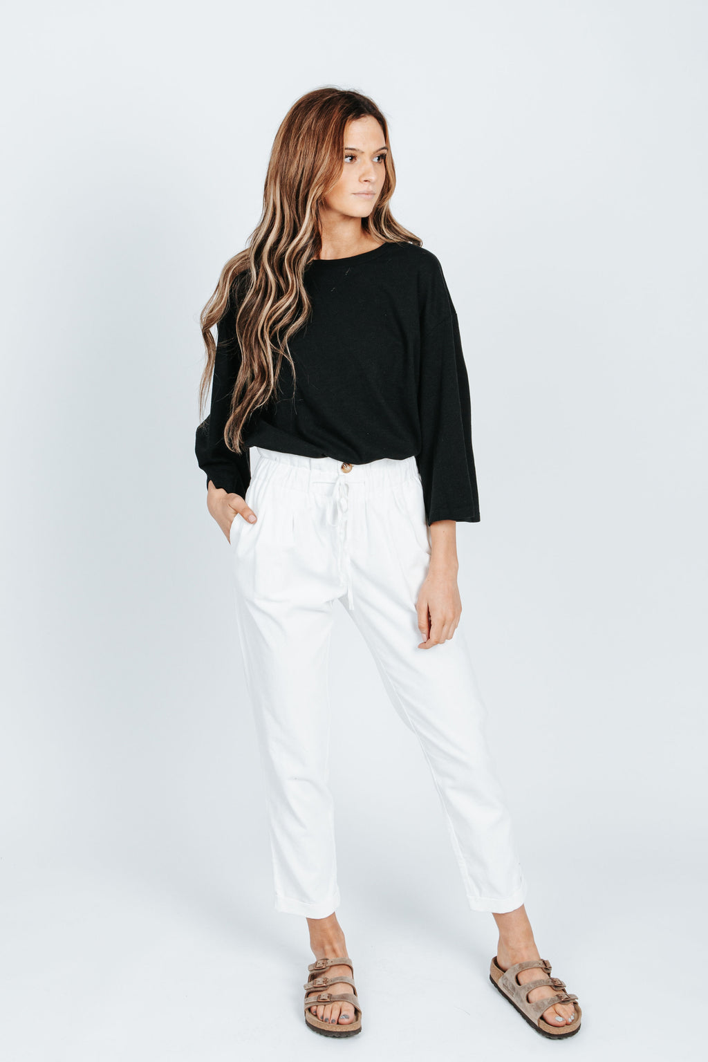 The Vincent Corduroy Trouser in White, studio shoot; front view