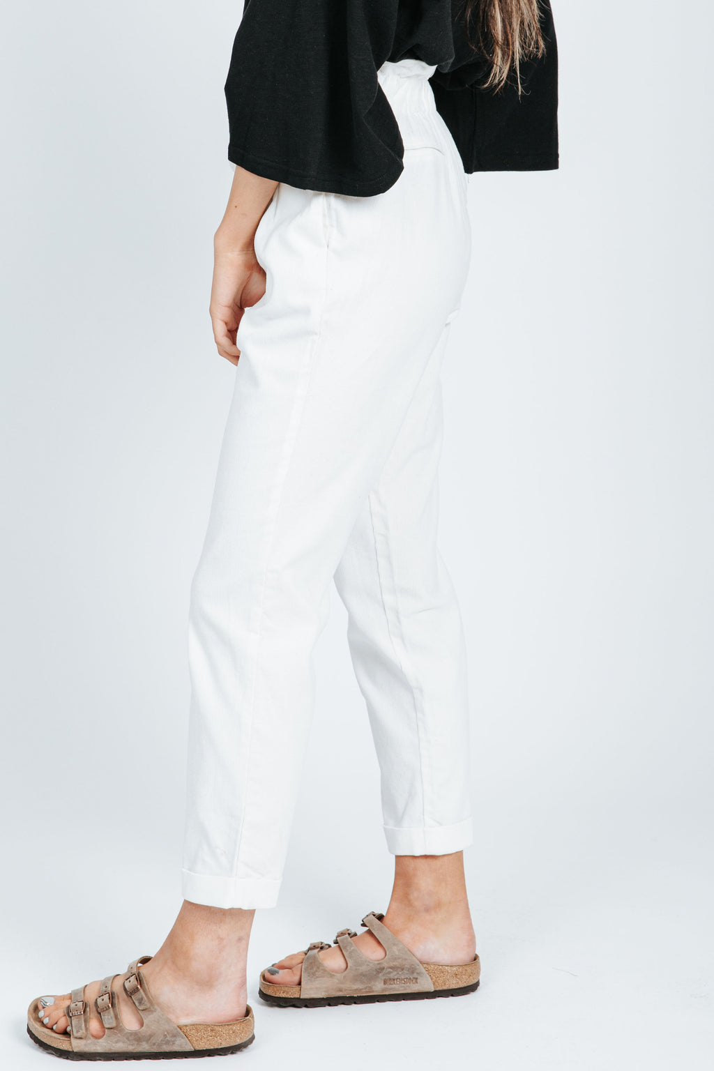 The Vincent Corduroy Trouser in White, studio shoot; side view