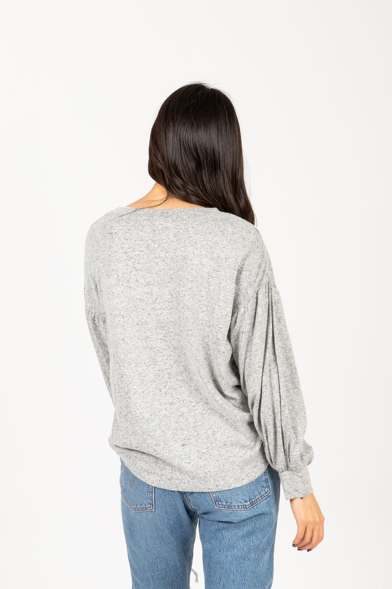 The Andrews Cozy Puff Sleeve Sweater in Heather Grey, studio shoot; back view
