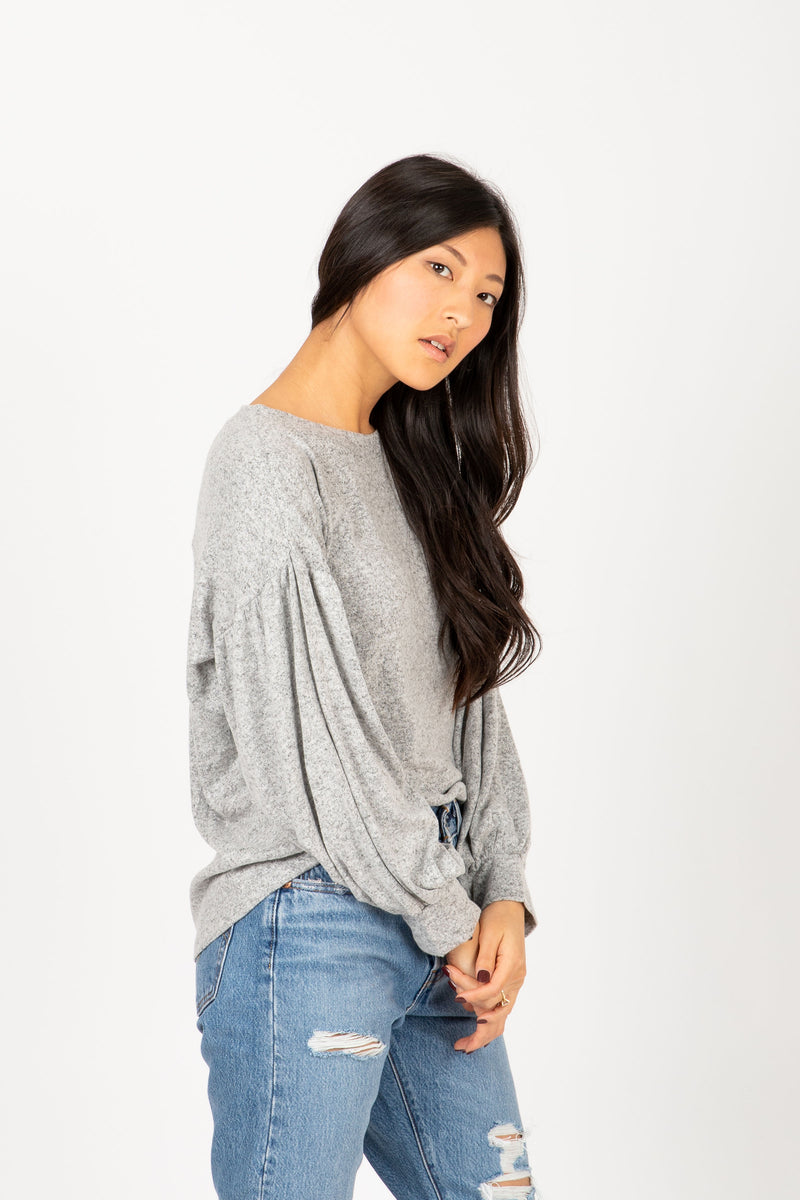 The Andrews Cozy Puff Sleeve Sweater in Heather Grey, studio shoot; side view