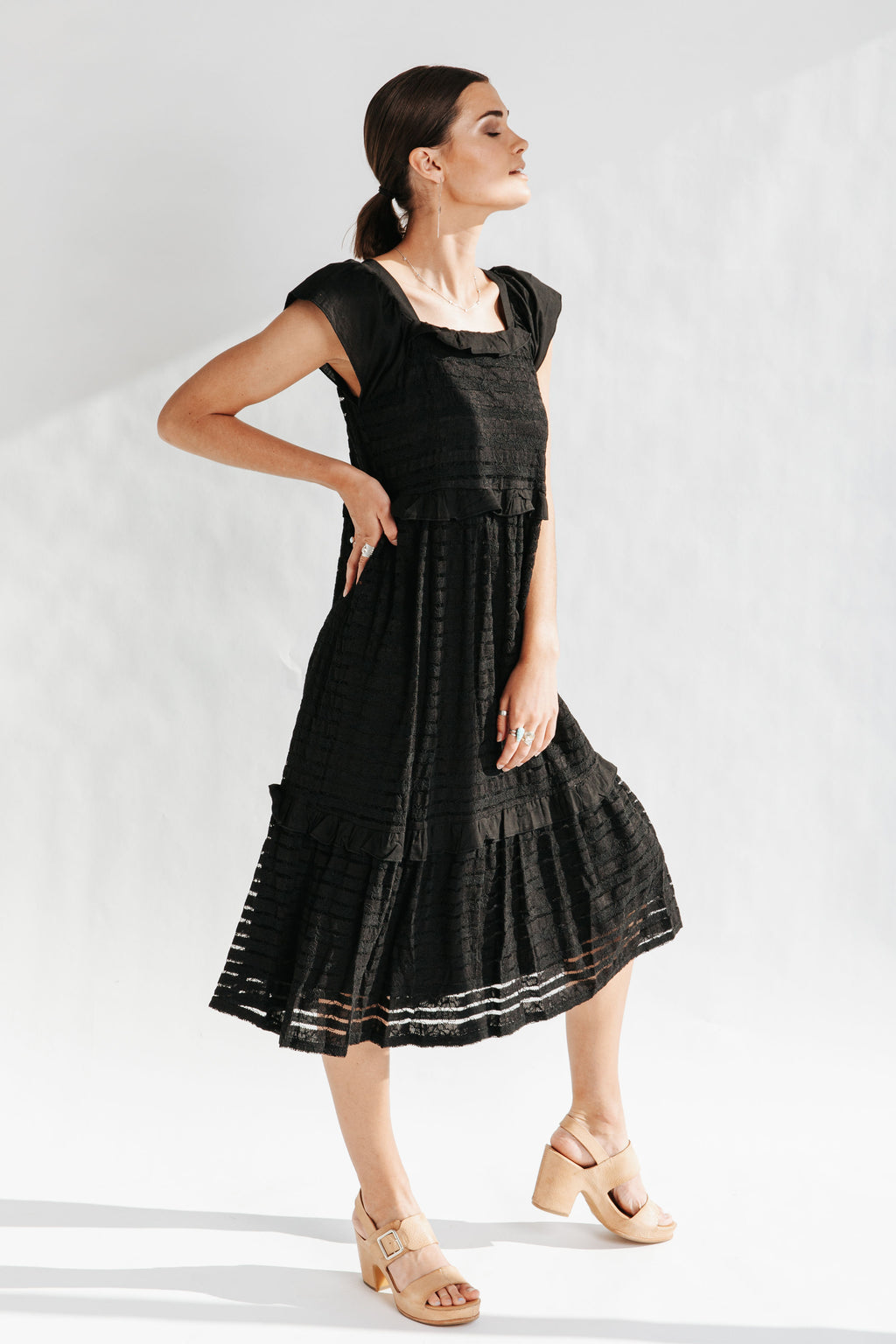 The Penny Lace Contrast Dress in Black, studio shoot; side view