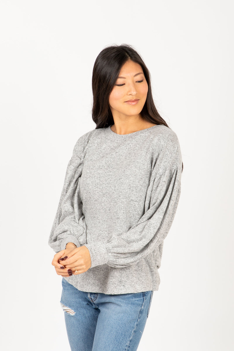 The Andrews Cozy Puff Sleeve Sweater in Heather Grey, studio shoot; front view