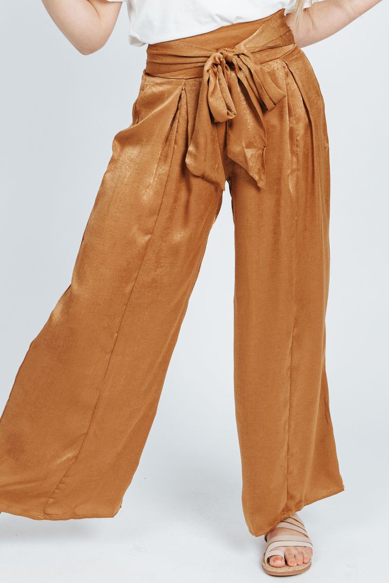 The Quinn Wide Leg Trouser in Gold, studio shoot; front view