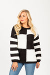The Louise Check Stripe Sweater in Black, studio shoot; front view