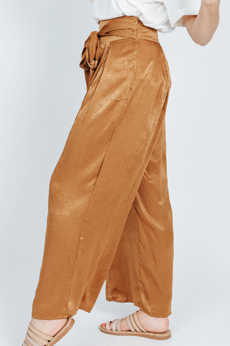 The Quinn Wide Leg Trouser in Gold, studio shoot; side view