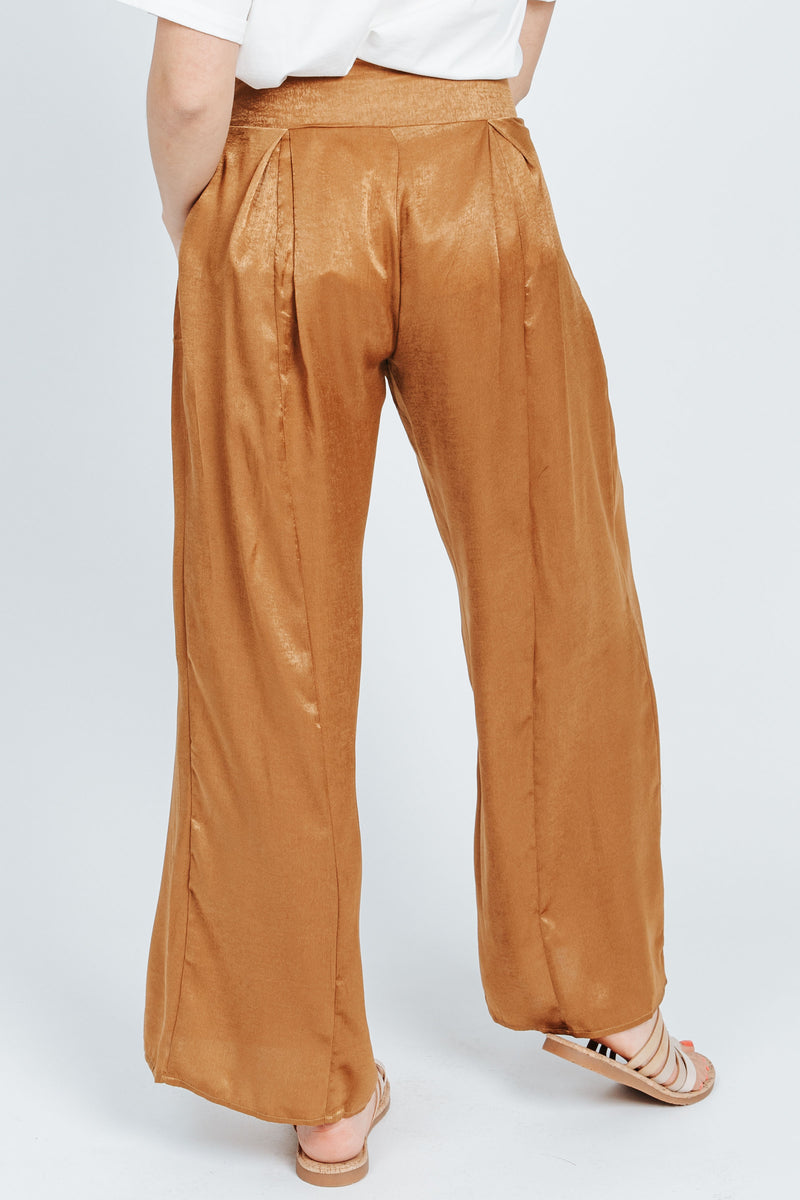 The Quinn Wide Leg Trouser in Gold, studio shoot; back view