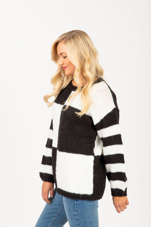 The Louise Check Stripe Sweater in Black, studio shoot; side view