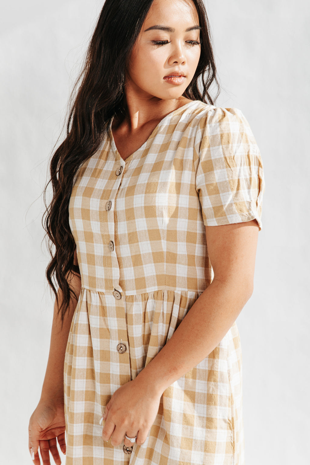 The Nilson Gingham Dress in Mustard, studio shoot; front view