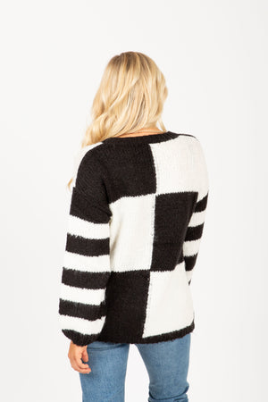The Louise Check Stripe Sweater in Black, studio shoot; back view