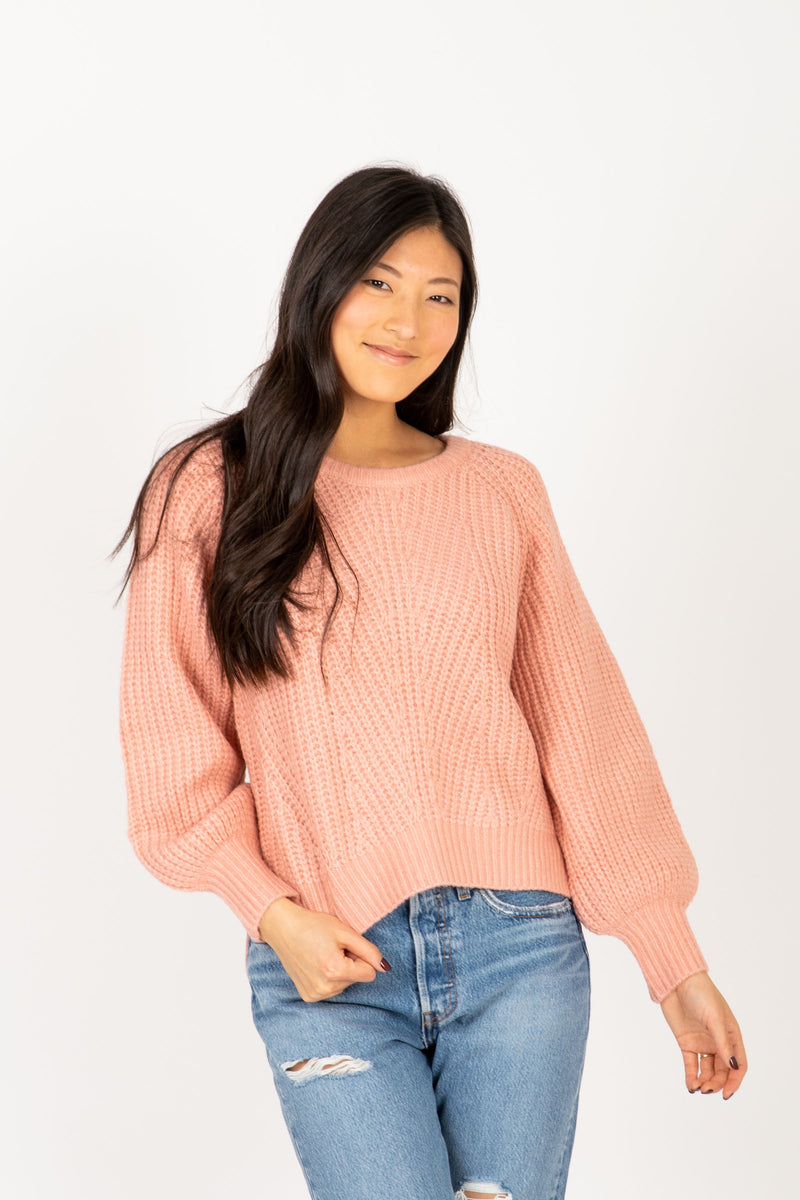The Trail Crochet Sweater in Pink, studio shoot; front view