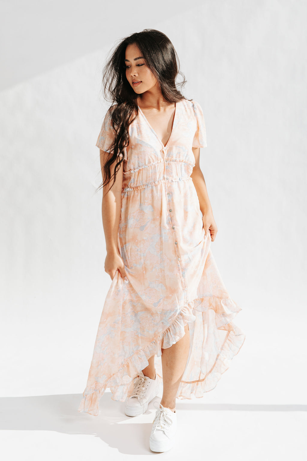 The Parsons Watercolor Dress in Peach, studio shoot; front view