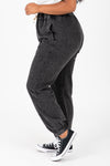 The Kravitz Washed Vintage Trouser in Black, studio shoot; side view