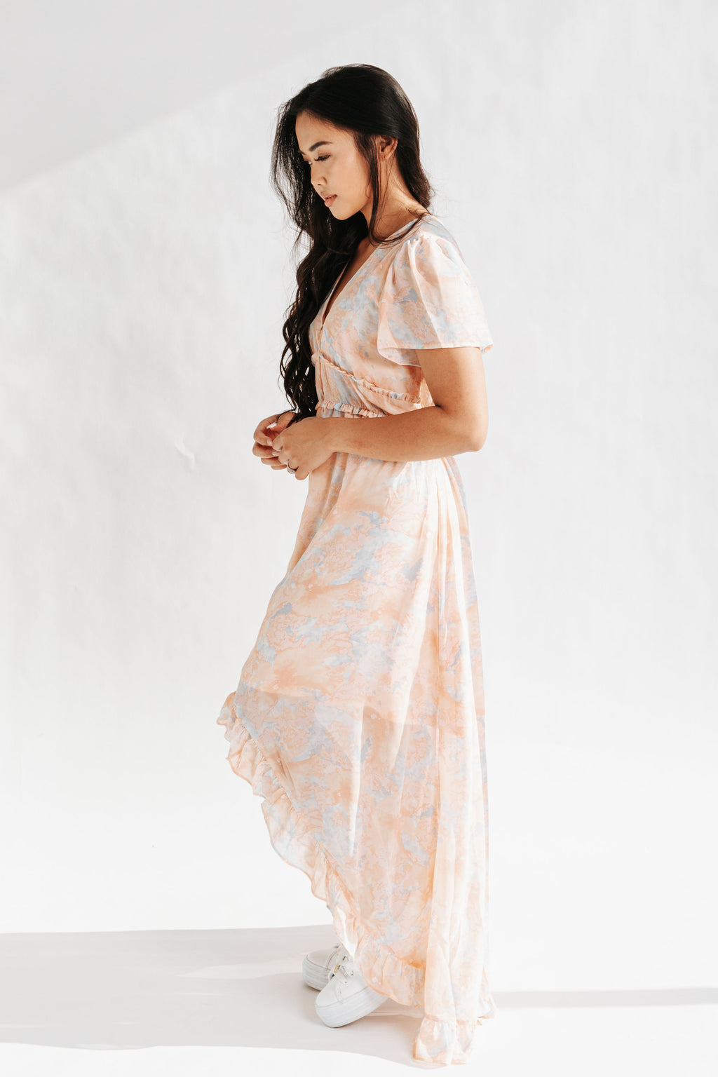 The Parsons Watercolor Dress in Peach, studio shoot; side view