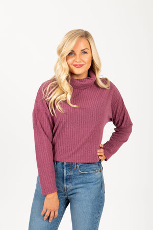 The Boreal Ribbed Turtleneck Blouse in Mauve, studio shoot; front view
