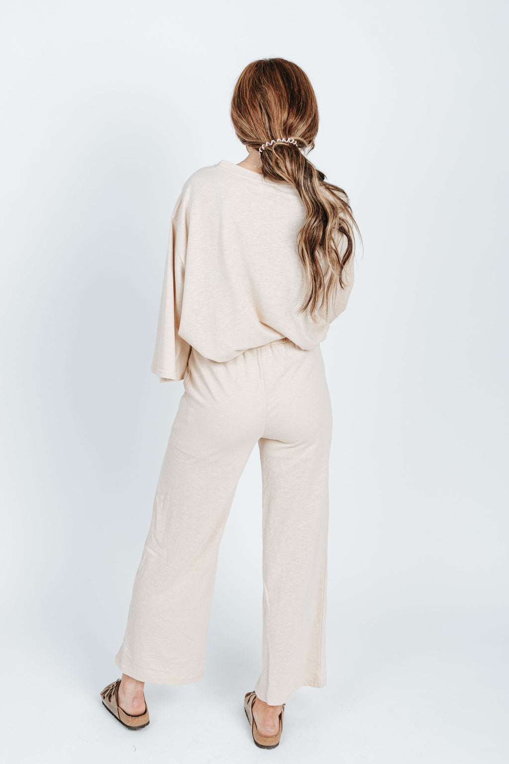 The Selena Casual Lounge Set in Natural, studio shoot; back view