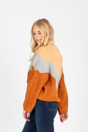 The Arianna V Sweater in Camel Multi, studio shoot; side view