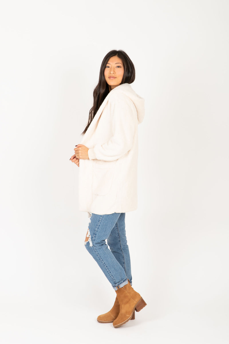 The Reach Cozy Hooded Cardigan in Ivory, studio shoot; side view