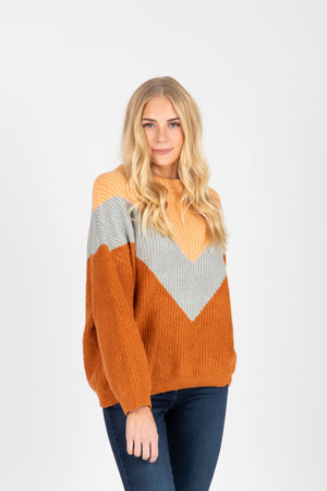 The Arianna V Sweater in Camel Multi, studio shoot; front view
