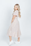 The Beverly Embroidered Wrap Dress in Blush, studio shoot; side view