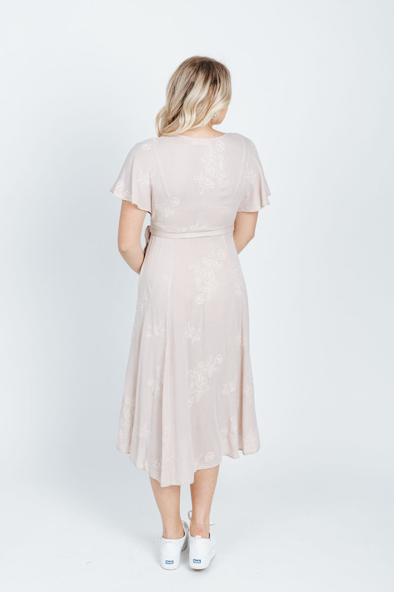 The Beverly Embroidered Wrap Dress in Blush, studio shoot; back view