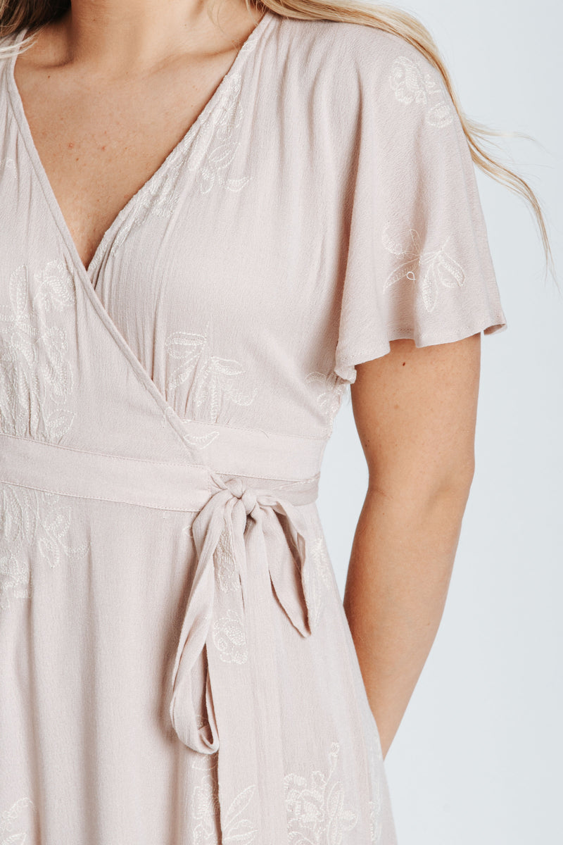 The Beverly Embroidered Wrap Dress in Blush, studio shoot; front view